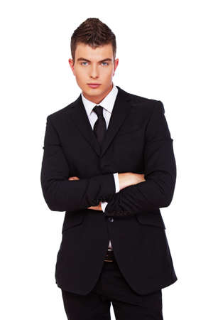 slick: A photo of a young businessman with his arms folded.
