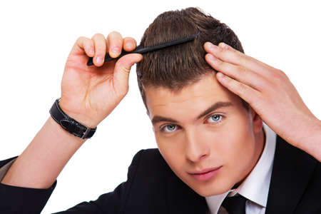 narcissist: A young man is smartening himself up