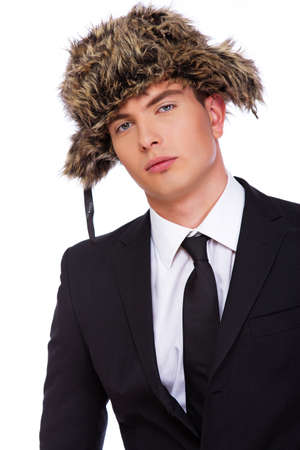 narcissist: A photo of a sexy young businessman in a fur hat