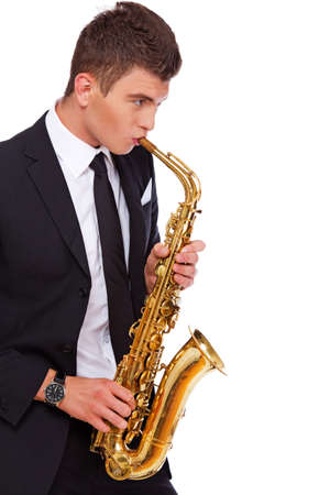 masterly: An attractive musician is playing saxophone