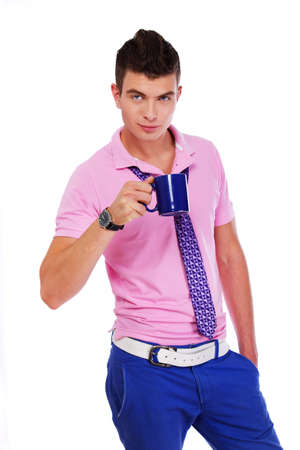 Picture of stylish young man with a blue cup photo