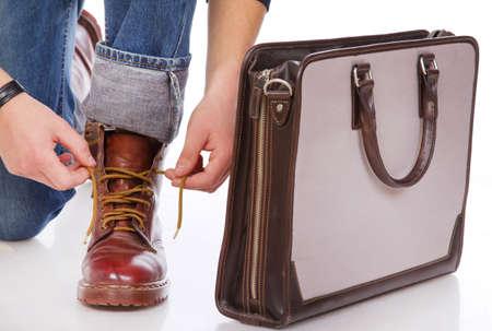 Close portrait of man shoes near the bag photo