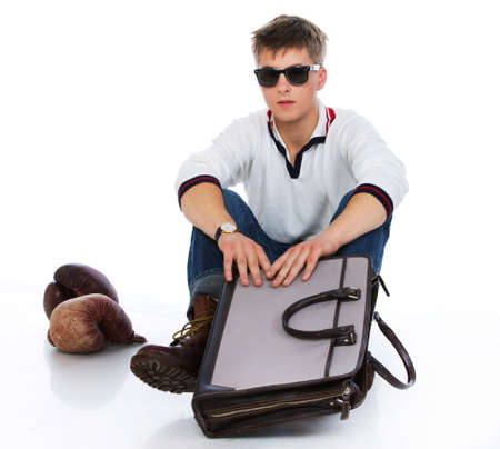 Portrait of sereous man posing in studio with bag photo