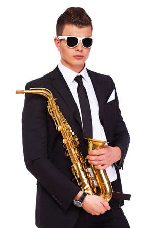 Photo of a man in suit posing with a saxophone photo