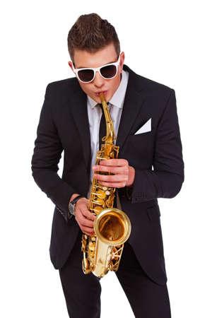 narcissist: Photo of a jazzman paying saxophone