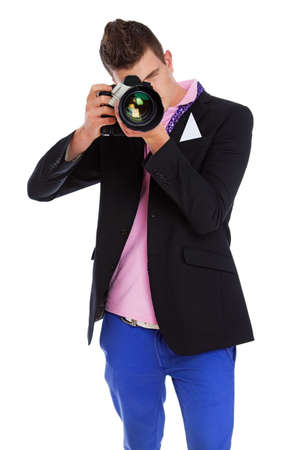 Photo of a young photogaph with his camera photo