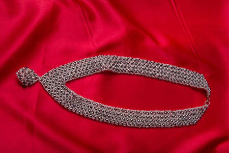 bijou: Bijou accessory closeup on red Stock Photo