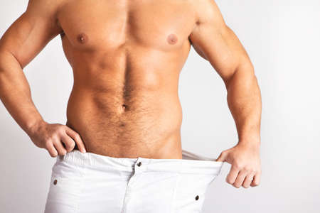 Muscular male body isolated on natural background