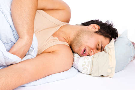 Man comfortably sleeping in his bed photo
