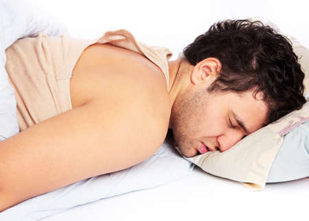 Man comfortably sleeping in his bed Stock Photo - 18208143