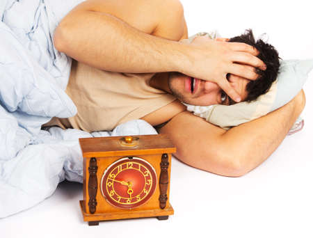 angry man and alarm clock in bedroom photo
