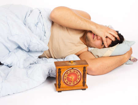 angry man and alarm clock in bedroom Stock Photo - 18208578