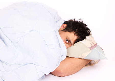 Young man  in bed , trying to sleep Stock Photo - 18208586