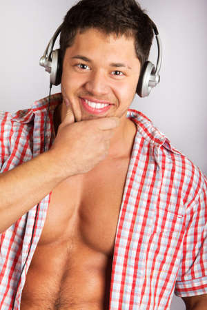 single songs: Handsome man listening to some music .over natural background Stock Photo