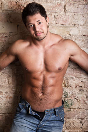Portrait of a muscular man posing against old wall Stock Photo - 18207976