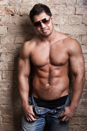 Portrait of a muscular man posing against old wall Stock Photo - 18207985
