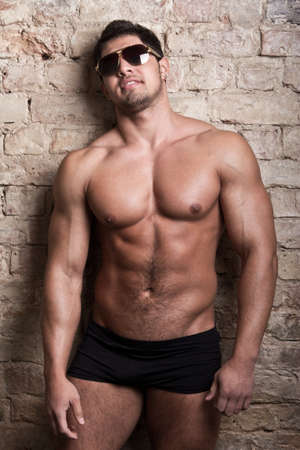 Portrait of a muscular man posing against old wall Stock Photo - 18208002