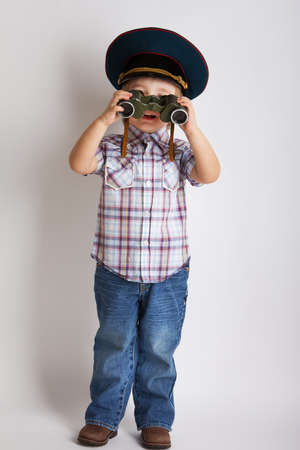 Little child boy looking binoculars lens isolated  photo