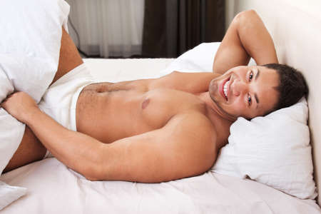 nude man:  Happy man lying in his bed