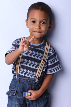 cute african american boy posing  studio shot photo