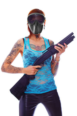 A young girl with multiple tattoos and a shotgun photo