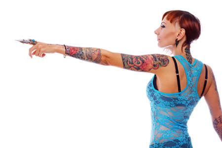 eastward: Photo of a tattoed young girl pointing eastward Stock Photo