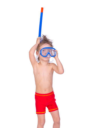 Portrait of young boy posing in studio with mask and tube in sweamwear photo