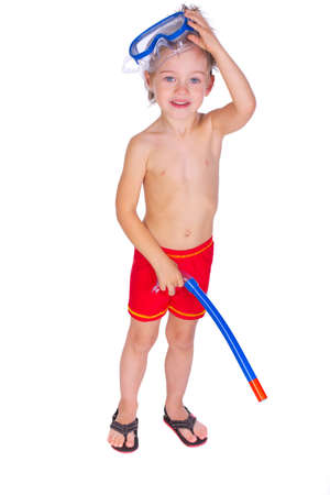 boy underwear: Portrait of young boy posing in studio with mask and tube in sweamwear
