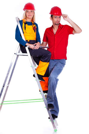 Portrait of couple posing in studio on ladder photo
