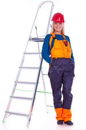 Portrait of sexy woman posing in studio on ladder photo