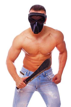 machete: Portrait of danger man in mask posing in studio