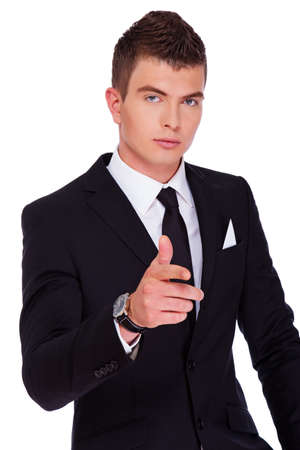 narcissist: Portrait of sexy man posing in studio in suit