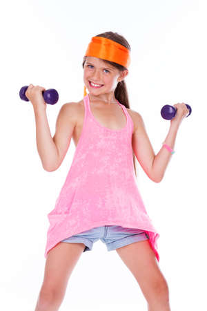 Portrait of strong girl posing in studio with dumbbells photo