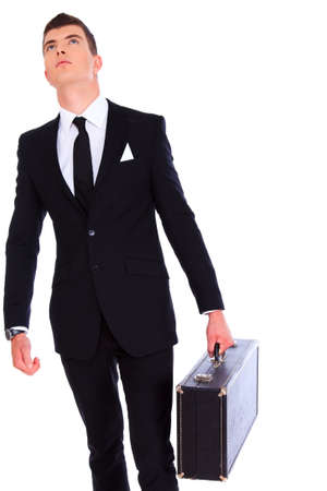 Handsome and fashionable man in a suit with bag over a white photo