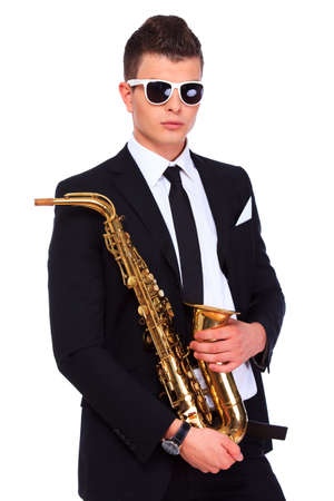Saxophonist in a suit and modern sunglasses over a white background photo