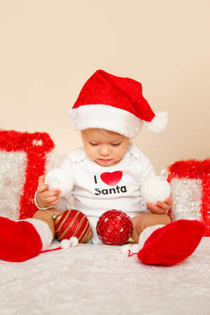 Portrait of child posing in studio in christmas with presents photo