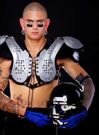 A football player wearing his protective gear photo