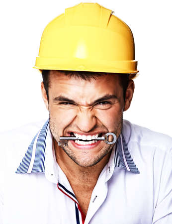 Portrait of crazy engineer eating key from house photo