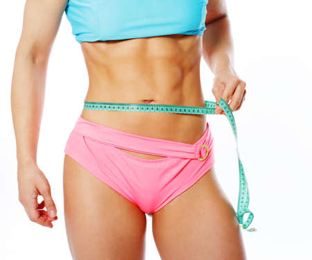 Portrait of sexy woman showing her abs in studio