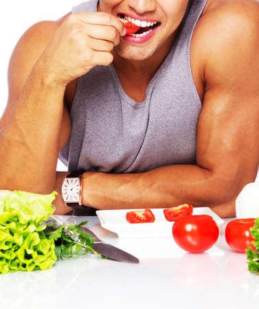 Portrait d'un homme sexy manger sur la cuisine Banque d'images - 25550608
