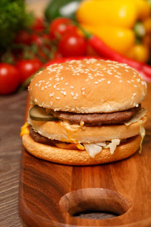 tempting: Tempting image of a hamburger on a wooden board