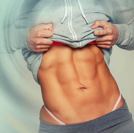 Sexy abs of a woman wearing sportswear photo