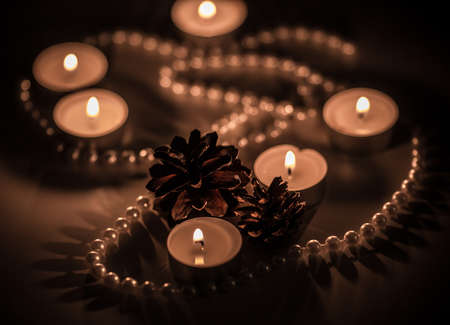 Candlelight and pearls with two cones photo