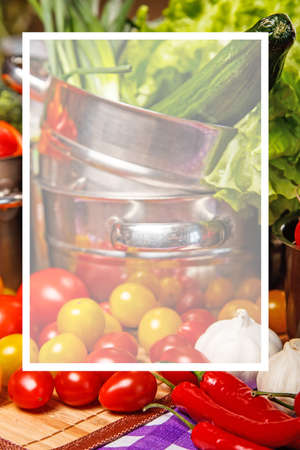 Salad, tomatoes and other veggies in metal cookware photo
