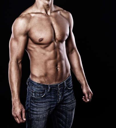 nude male: Portrait of sexy muscle man posing in studio