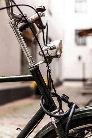Closeup picture of a rusty bike lamp photo