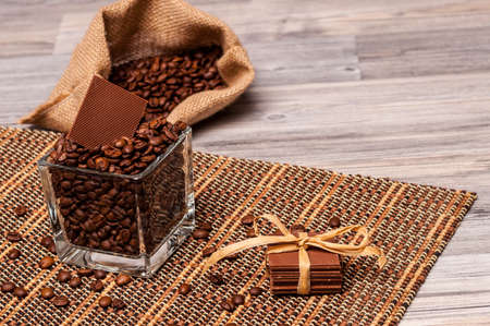 Chocolate, a jar and a sack of coffee beans photo