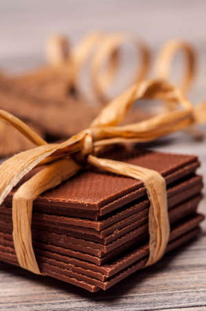 semisweet: Thin pieces of chocolate stacked and tied with a ribbon