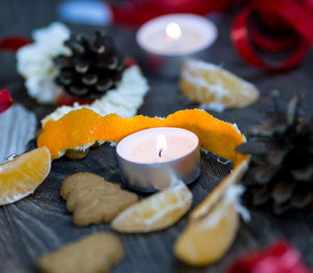 Mandarin peel and tea candles with gingerbread cookies photo