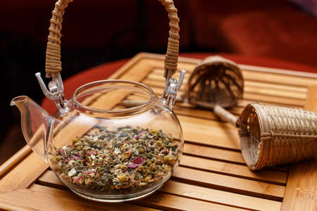 curative: Transparent teapot and two organic tea strainers Stock Photo